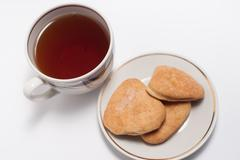 cup of tea and some cookies - stock photo
