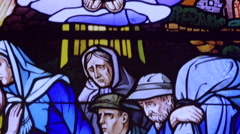 Poor people & saint sebastien depicted on stained glass window, panting Stock Footage