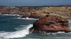 blue water near the rocks of the west coast of Portugal - stock footage