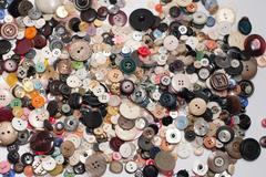 Lots of buttons scattered - stock photo