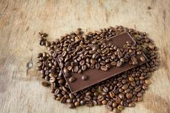 Tiles of dark chocolate and coffee beans Stock Photos