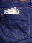 Hands holding money. Bribe in businessmen's pocket. Dollars cur Stock Photos