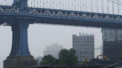 View of building and vehicle moving on Brooklyn Bridge, New York City, USA Stock Footage