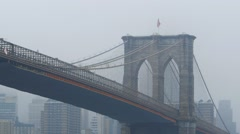 United States Flag at top of Brooklyn Bridge, New York City, USA Stock Footage