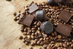 Tiles of dark chocolate candy coffee beans Stock Photos
