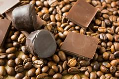 Tiles of dark chocolate candy coffee beans Stock Photos