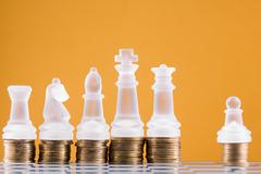 Chess on a golden coins. Investment strategy. Finance concept - stock photo