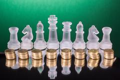 Chess on a golden coins. Investment strategy. Finance concept Stock Photos