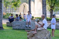 BANGKOK, THAILAND - 2016 March 06: Old man reading a favorite book and relaxi Stock Photos