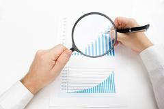 Businessman counting losses and profit working with statistics, analyzing - stock photo