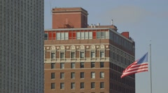View of buildings and American flag - stock footage