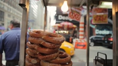 Stack of doughnuts in roadside stall Stock Footage