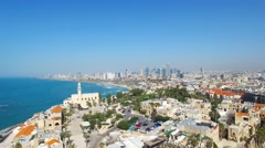 Stock Video Footage of Tel Aviv - Jaffa, Aerial footage moving in from the mediterranean sea