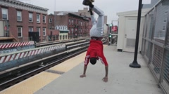 Man performing trick on railway platform Stock Footage