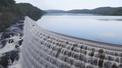 View of river water flowing from dam Stock Footage