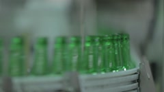 Bottles moving on conveyor belt in Yuengling factory Stock Footage