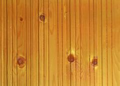 Lacquered wooden surface with knots Stock Photos