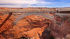 Steel Arch Bridge and Visitor Center at Glen Canyon Dam - stock photo