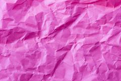 Textured background of wrinkled pink paper - stock photo