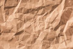 Textured background of wrinkled brown paper - stock photo