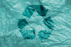 Recycling symbol on  plastic background Stock Photos