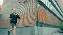 Young Sporty Girl Jogging In Slow Motion Stock Footage