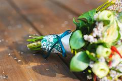 Bouquet with turquoise ribbon Stock Photos