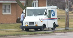 Postal Worker gets in US Mail Truck and drives off - 4k Stock Footage