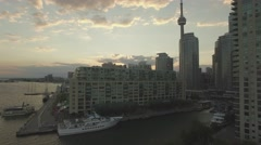 4k Aerial shot waterfront overlooking city during sunset camera ascent - stock footage