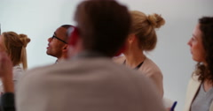 Multi ethnic business team members attending presentation in meeting room Stock Footage