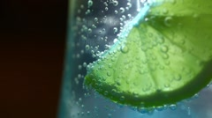 Stock Video Footage of Lemon in soda