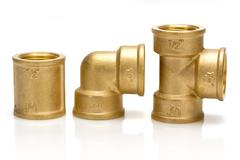 brass fittings for plumbing pipes - gon, tee, sleeve - stock photo