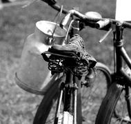 Old rusty bicycle milkman and the Milk Canister Stock Photos