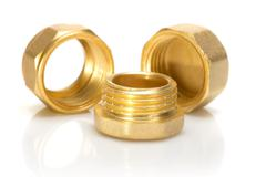 brass fittings for plumbing pipes - bung - stock photo