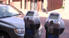 Woman Feeds Parking Meter 3 Stock Footage