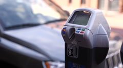 Woman Feeds Parking Meter 1 Stock Footage