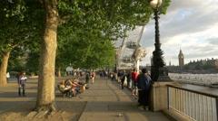 Relaxing in Jubilee Gardens in London Stock Footage