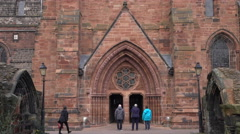 Carlisle Cathedral members at beautiful historic entrance England 4K Stock Footage