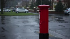 Iconic English post box in the rain, England, Europe Stock Footage
