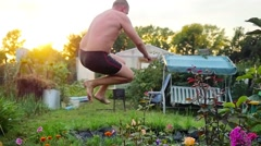 In the summer, man is bathed dives, jumps into the pond during sunset. Water Stock Footage