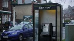 English phone box in the rain Stock Footage
