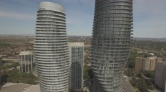Stock Video Footage of 4k Aerial shot Absolute Condos Mississauga camera circle around in a sunny da