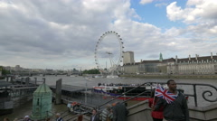 The iconic London Eye seen from across the river in London Stock Footage
