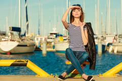 woman in marina against yachts in port - stock photo