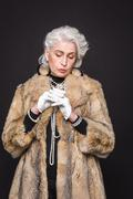 Stock Photo of Senior rich woman
