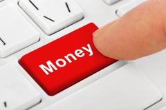 Computer notebook keyboard with Money key - stock photo