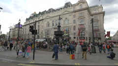 People relaxing near Shaftesbury Memorial Fountain in London Stock Footage
