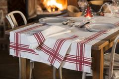 Tablecloth of Red Stripe Design and Dinnerware Arranged for Meal Stock Photos