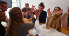 Business colleagues giving eachother high five in meeting Stock Footage
