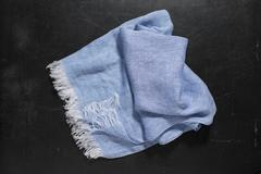 Blue Hand Towel with White Fringes on Dark Surface Stock Photos